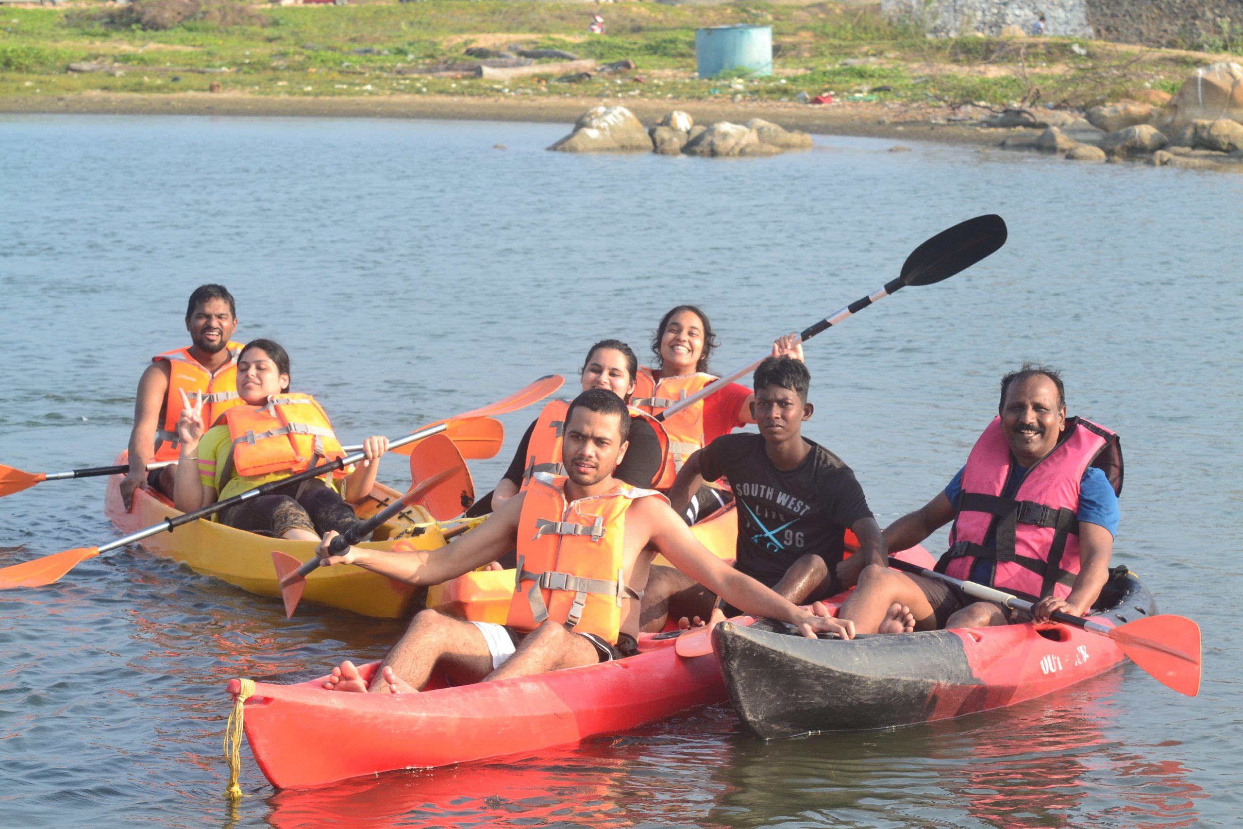 Students enjoying kayaking at Kovalam Beach